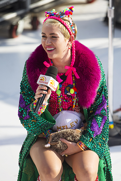 Miley Cyrus performs for 'Sunrise', at the opera house in Sydney, Australia