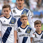 CARSON, CA - DECEMBER 01:  David Beckham #23 of Los Angeles Galaxy stands up the field with his sons Brooklyn, Romeo and Cruz before the Galaxy take on the Houston Dynamo in the 2012 MLS Cup at The Home Depot Center on December 1, 2012 in Carson, California.  (Photo by Harry How/Getty Images)